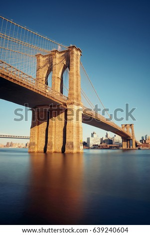 Brooklyn bridge at waterfront in downtown Manhattan New York City.