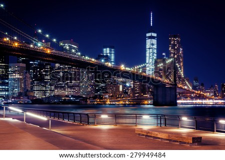 Stock Photo Brooklyn Bridge, Downtown Manhattan, New York. Night scene. Light trails. City lights. Urban living and transportation concept