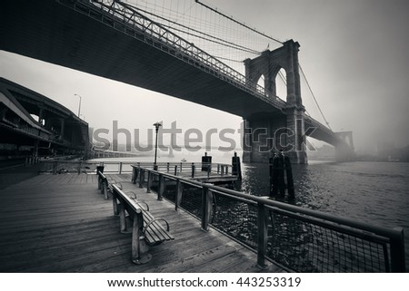 Brooklyn Bridge in a foggy day in downtown Manhattan #443253319