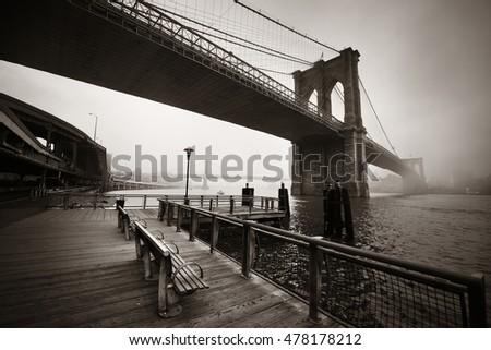 Brooklyn Bridge in a foggy day in downtown Manhattan #478178212