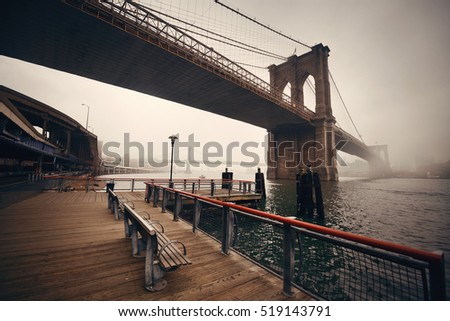 Brooklyn Bridge in a foggy day in downtown Manhattan #519143791