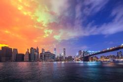 Brooklyn Bridge in a warm summer Day to Night New York City, USA