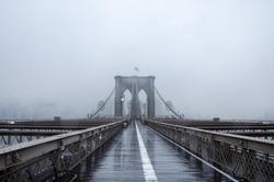 Brooklyn bridge, New York City. USA. New York in a foggy day in downtown Manhattan. Deserted city.