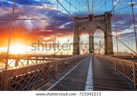 Stock Photo Brooklyn Bridge over East River viewed from New York City Lower Manhattan waterfront at sunset.