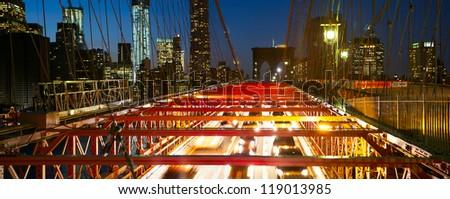 Brooklyn Bridge panorama with traffic at dusk, New York City