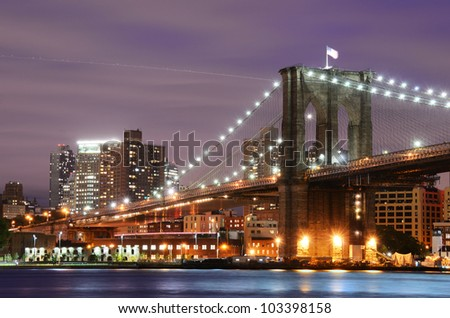 Brooklyn Bridge spanning the East River towards Manhattan in New York City.