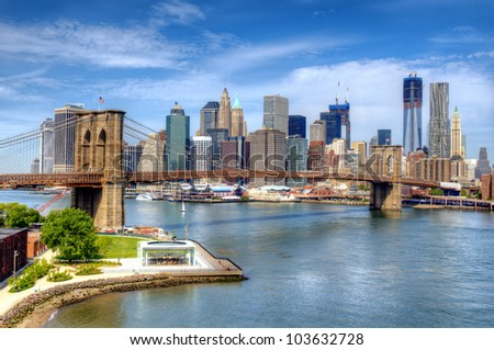 Brooklyn Bridge spans the East River towards Lower Manhattan in New York City.