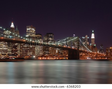stock-photo-brooklyn-bridge-with-new-york-city-skyline-in-background-6368203.jpg