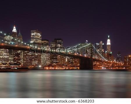 stock-photo-brooklyn-bridge-with-new-york-city-skyline-in-background-6368203.jpg