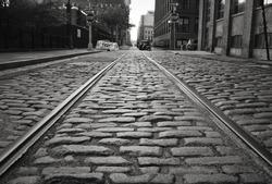 Brooklyn cobblestone street with train tracks.