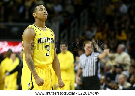 BROOKLYN-DEC 15: Michigan Wolverines guard Trey Burke (3) reacts on the court against the West Virginia Mountaineers during the second half at Barclays Center on December 15, 2012 in Brooklyn.