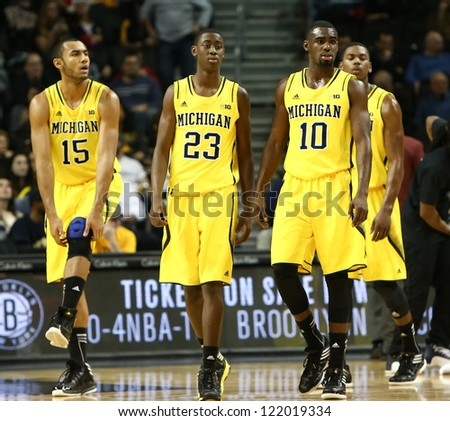 BROOKLYN-DEC 15: Michigan Wolverines Jon Horford (15), Caris LeVert (23), and Tim Hardaway Jr. (10) against the West Virginia Mountaineers at Barclays Center on December 15, 2012 in Brooklyn.