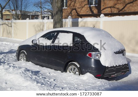 BROOKLYN, NEW YORK - JANUARY 22: Car under snow on January 22, 2014 in Brooklyn, NY after massive Winter Storm Janus strikes Northeast. Foot of snow hits NYC as Northeast reels from Winter Storm Janus