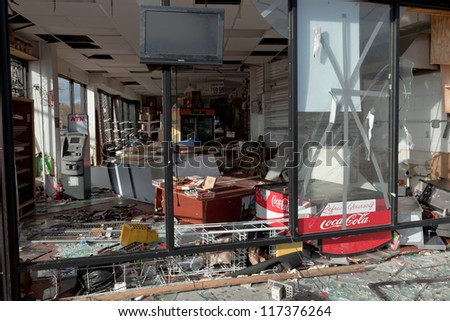 BROOKLYN, NEW YORK - OCTOBER 30: The damaged store in the aftermath of the Superstorm Sandy on October 30, 2012 in the Sheepshead Bay, Brooklyn, New York, USA. - stock photo