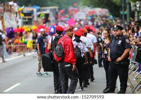 BROOKLYN, NEW YORK - SEPTEMBER 2 2013: The 46th annual West Indian Day Parade caps a long, holiday weekend of Caribbean-themed celebration as flamboyance fills Eastern Parkway on September 2 2013 in Brooklyn