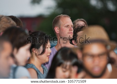 BROOKLYN, NY - JUNE 20:  Attendees wait outside at the Northside Festival screening of Ai WeiWei: Never Sorry, directed by Alison Klayman, presented by IFC at UnionDocs in Brooklyn, NY on June 20,2012. - stock photo