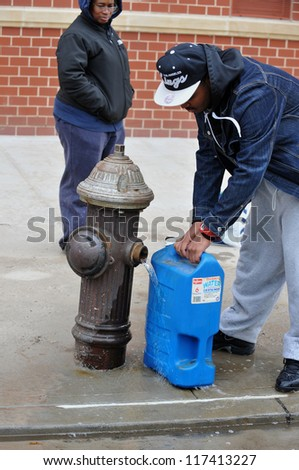BROOKLYN, NY - NOVEMBER 01: People at the Seagate neighborhood feeling up water from fire hydrant  due to impact from Hurricane Sandy in Brooklyn, New York, U.S., on Thursday, November 01, 2012.