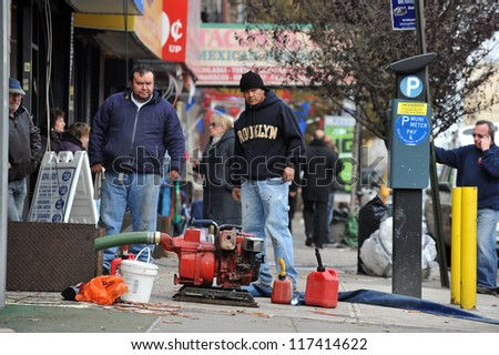 BROOKLYN, NY - NOVEMBER 01: People pumping water out buildings at the Brighton Beach neighborhood due to impact from Hurricane Sandy in Brooklyn, New York, U.S., on Thursday, November 01, 2012.