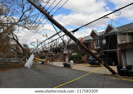 BROOKLYN, NY - NOVEMBER 03: Trees and electric poles felt down to the ground in the Sheapsheadbay neighborhood due to strong wind from Hurricane Sandy in Brooklyn, NY, U.S., on November 03, 2012.