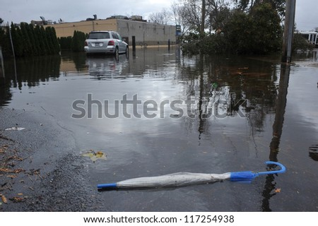 BROOKLYN, NY - OCTOBER 30: A dropped umbrella on the ground in the Sheapsheadbay neighborhood due to flooding from Hurricane Sandy in Brooklyn, New York, U.S., on Tuesday, October 30, 2012.