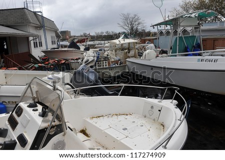 BROOKLYN, NY - OCTOBER 30: Boats smashed to the ground in the Sheapsheadbay neighborhood due to flooding from Hurricane Sandy in Brooklyn, New York, U.S., on Tuesday, October 30, 2012.