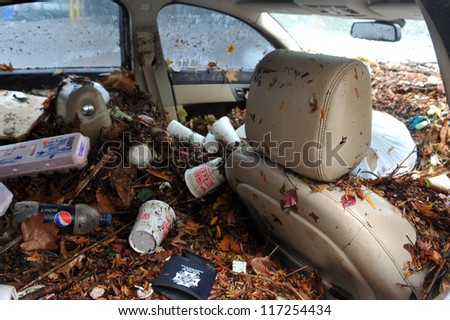 BROOKLYN, NY - OCTOBER 30: Debris litters inside abondoned cars in the Sheapsheadbay neighborhood due to flooding from Hurricane Sandy in Brooklyn, New York, U.S., on Tuesday, October 30, 2012.