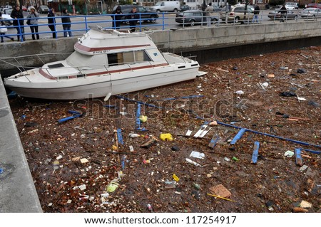 BROOKLYN, NY - OCTOBER 30: Debris litters the water in the Sheapsheadbay neighborhood due to flooding from Hurricane Sandy in Brooklyn, New York, U.S., on Tuesday, October 30, 2012.