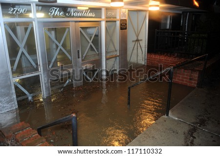 BROOKLYN, NY - OCTOBER 29: Flooded building entrance, caused by Hurricane Sandy, seen on October 29, 2012, in the corner of Bragg street and  Shore Pway of Brooklyn NY, United States.