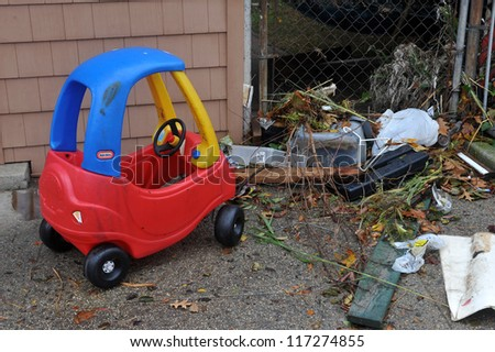 BROOKLYN, NY - OCTOBER 30: Kid toy and debris litters the ground in the Sheapsheadbay neighborhood due to flooding from Hurricane Sandy in Brooklyn, New York, U.S., on Tuesday, October 30, 2012.