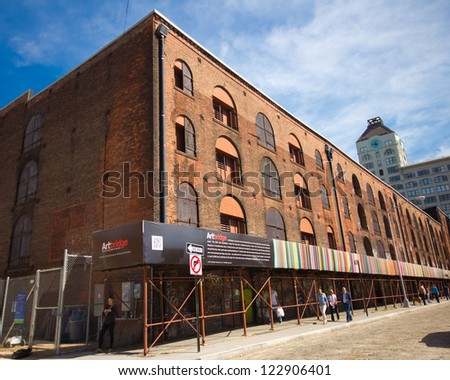 BROOKLYN, NY - SEPT 16:  Historic Empire Stores building with Chromatweet Artbridge installation in DUMBO Brooklyn on Sept 16, 2012. Macasev�s ChromaTweet was part of  the Dumbo Arts Festival in 2011.
