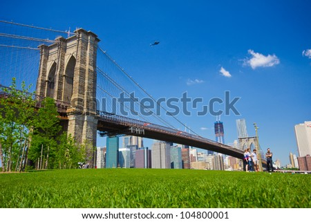 BROOKLYN, NYC - MAY 18:  Brooklyn Bridge as seen from Brooklyn Bridge Park, New York City on May 18, 2012.  Landmark Brooklyn Bridge is one of the oldest suspension bridges in the United States. - stock photo