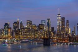 Brooklyn park, Brooklyn Bridge, Janes Carousel and Lower Manhattan skyline at night seen from Manhattan bridge, New York city, USA.