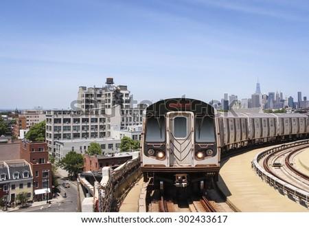 Brooklyn skyline with subway train