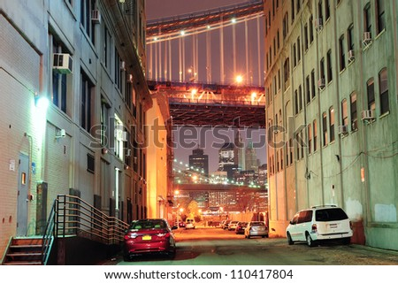 Brooklyn street view at night with New York City Manhattan downtown skyline, Brooklyn Bridge and Manhattan Bridge.