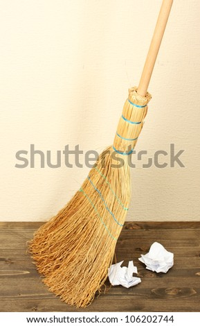 Broom and papers on floor in room