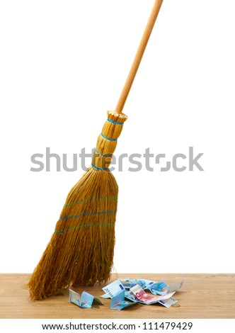 Broom sweep the euro on white background close-up