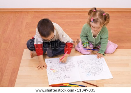 Brother and sister coloring the tale book