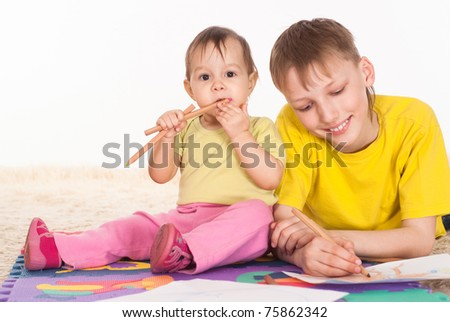 brother and sister drawing and dreaming on white background