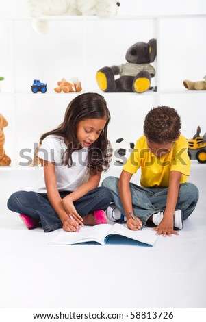 brother and sister drawing on book