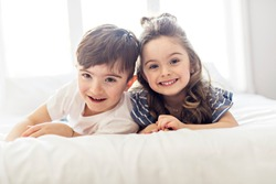 Brother And Sister having fun Together on Bed