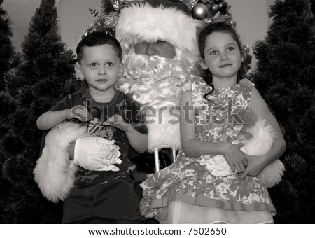 Brother and Sister in Santa's Lap