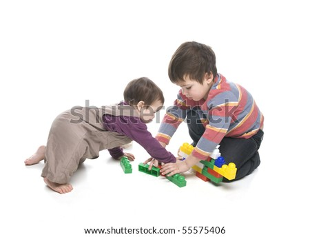 Brother and sister playing together over white background