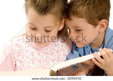 brother and sister reading a big book