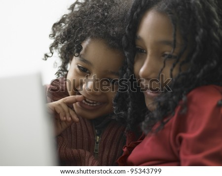 Brother and sister using a laptop
