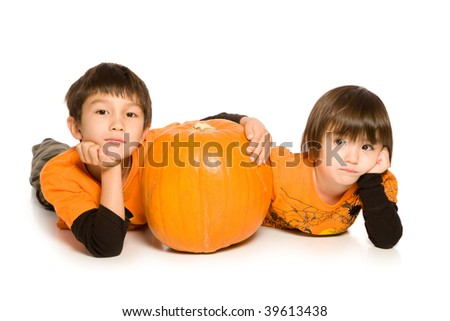 Brother and Sister with Pumpkin on pure white background