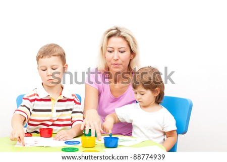 brother and the sister draw finger-type paints - stock photo