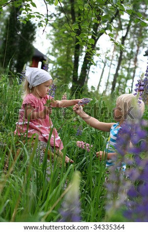 Brother giving flower for his little sister