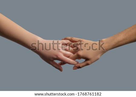 Brotherhood of mankind. Close-up of people from different races interlocking fingers