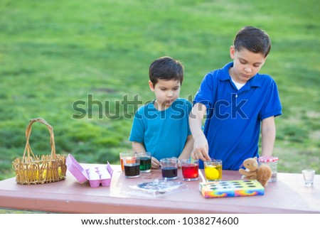 Brothers Coloring Easter Eggs
