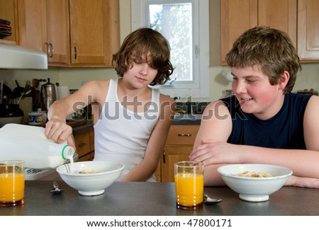 Brothers having breakfast